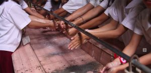 School girls washing hands in the Philippines